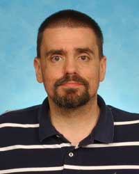 A headshot photo of Jason D. Huber.