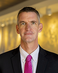 A headshot photo of James J. Mahoney III.