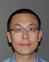 A headshot photo of Shuo Wang.
