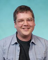 A photo of Joshua Kelley.