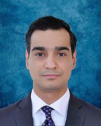A photo of M. Husain.