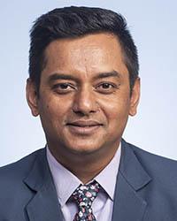 A photo of Dharendra Thapa.