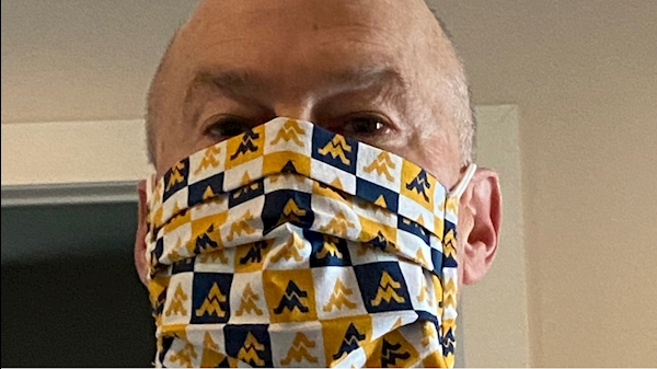 A picture of me posing with my new Flying WV West Virginia University facial covering.