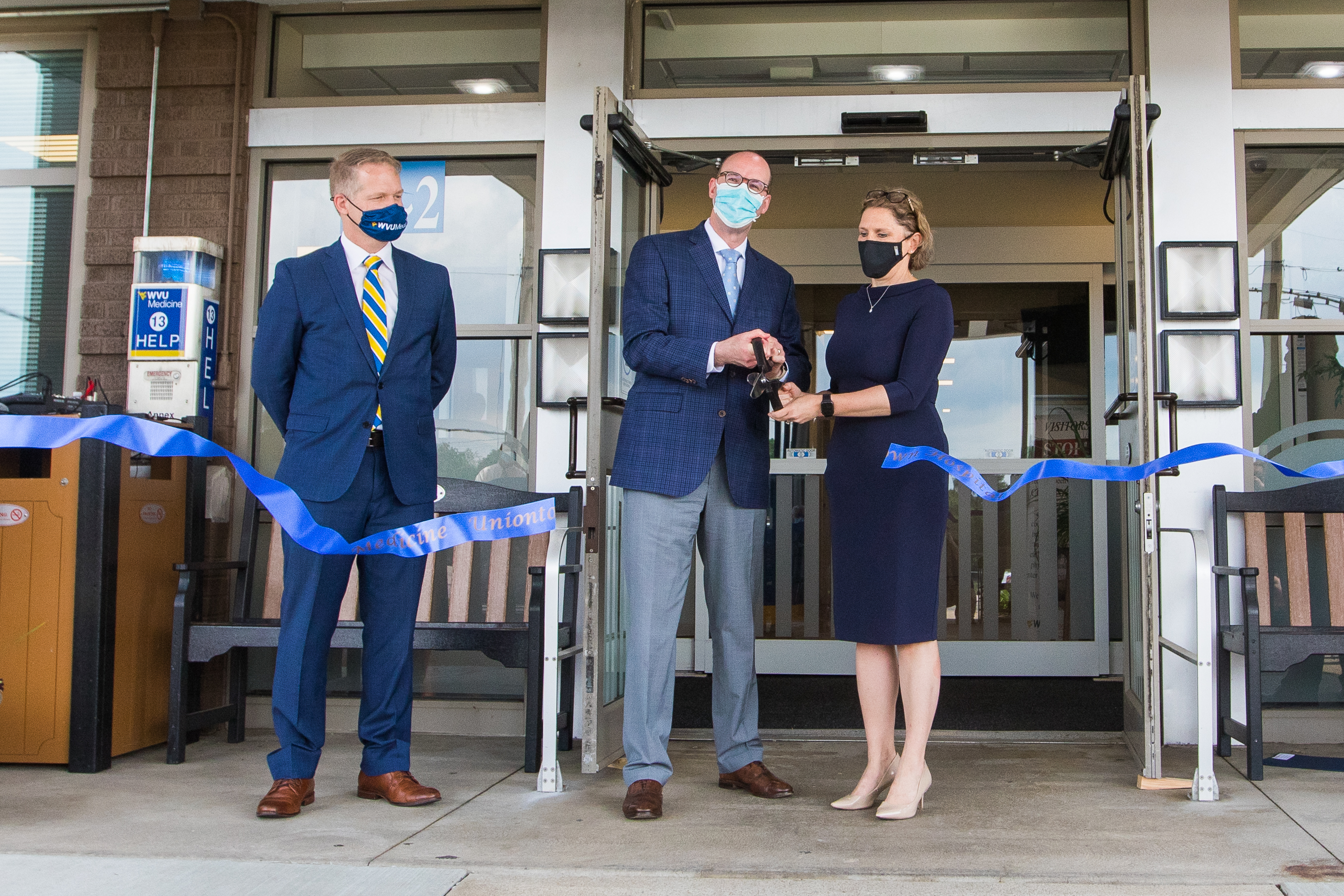 Albert Wright, Jr., WVU Medicine president and CEO, and Hannah Hazard-Jenkins, M.D., WVU Cancer Institute director, cut the ribbon marking the opening of the Cancer Center in Uniontown.