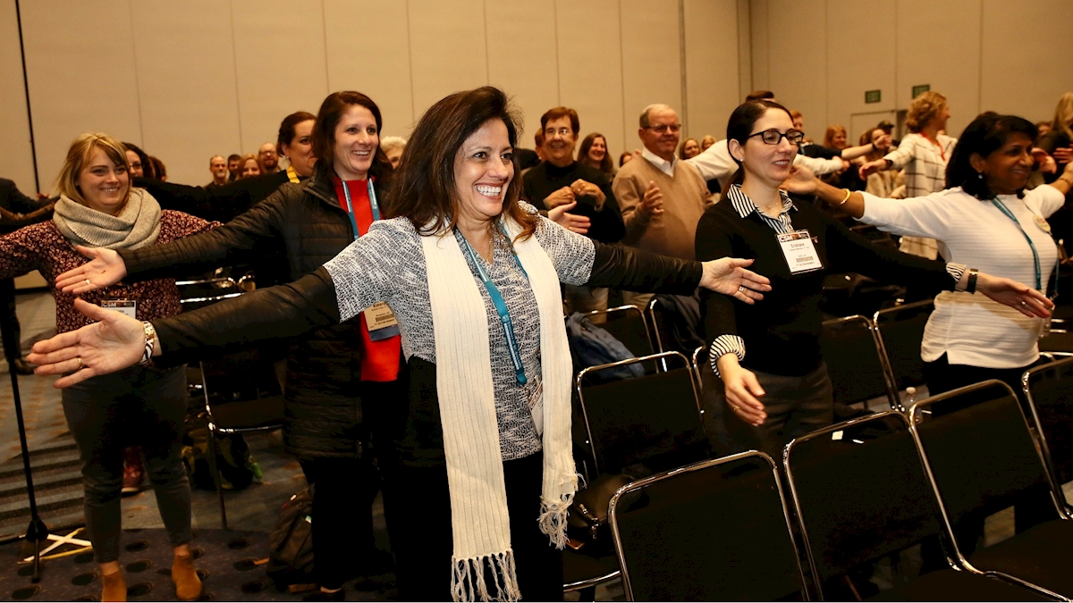 Attendees participate during conference.