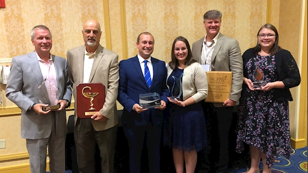 Alumni and faculty pose with their awards at the 11th annual WVPA Convention.