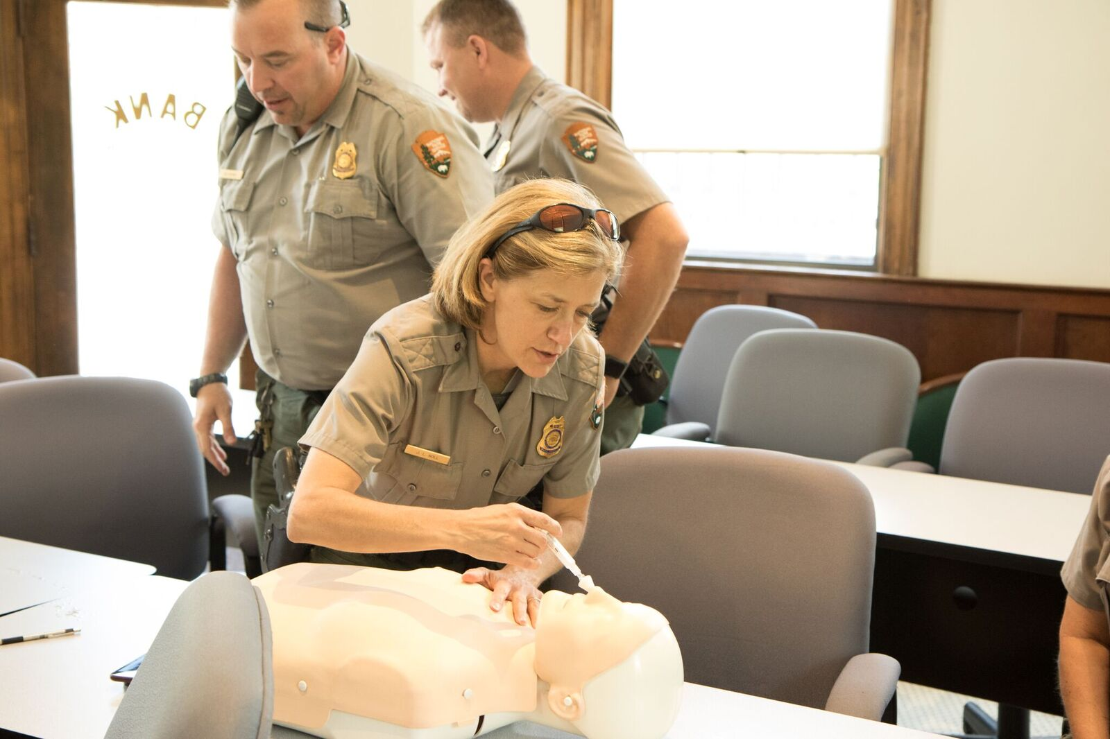 New River Gorge National River Ranger Jenny Noll practices administering intranasal naloxone using a saline solution during a training session.