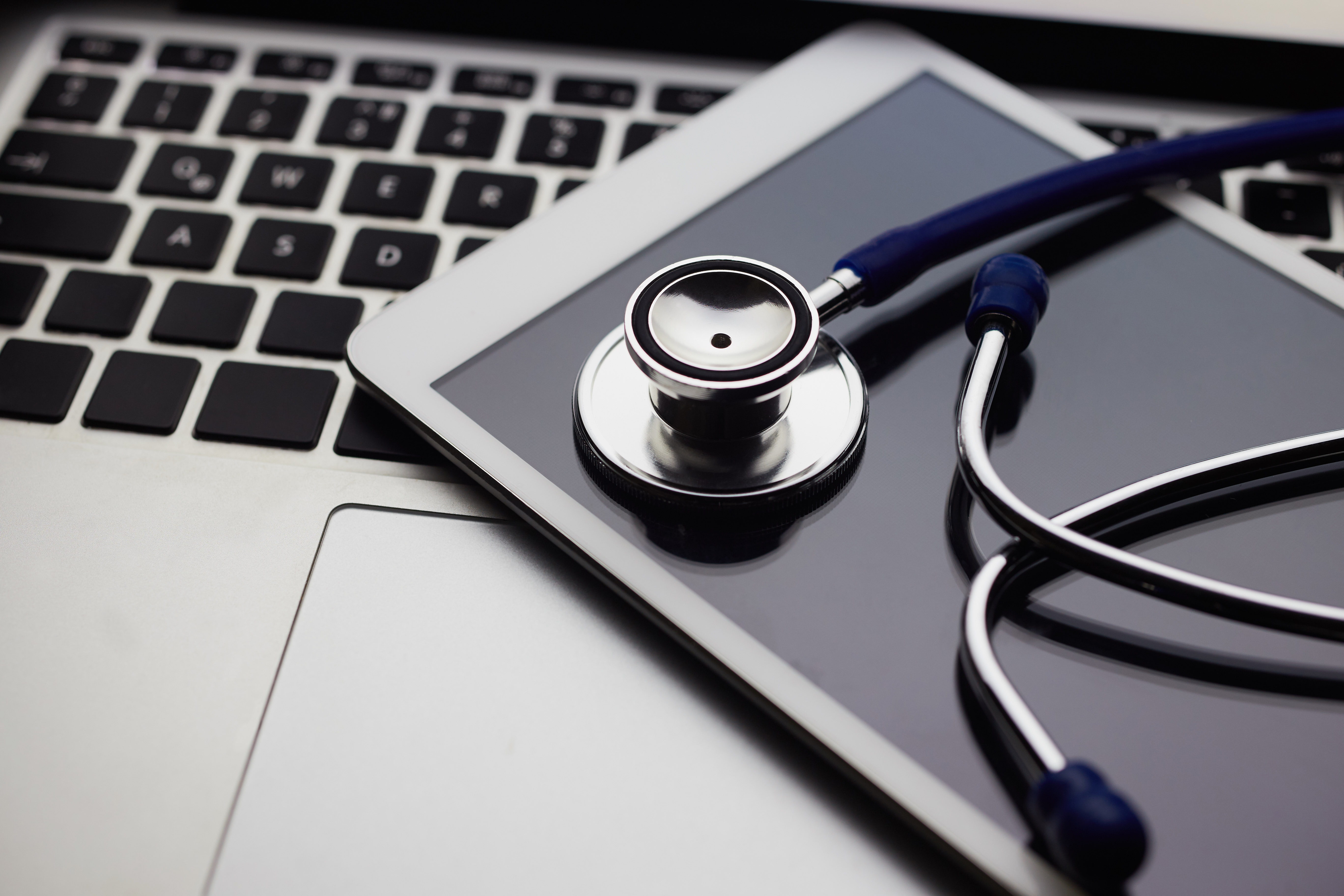 Stock image of keyboard, tablet, and stethoscope