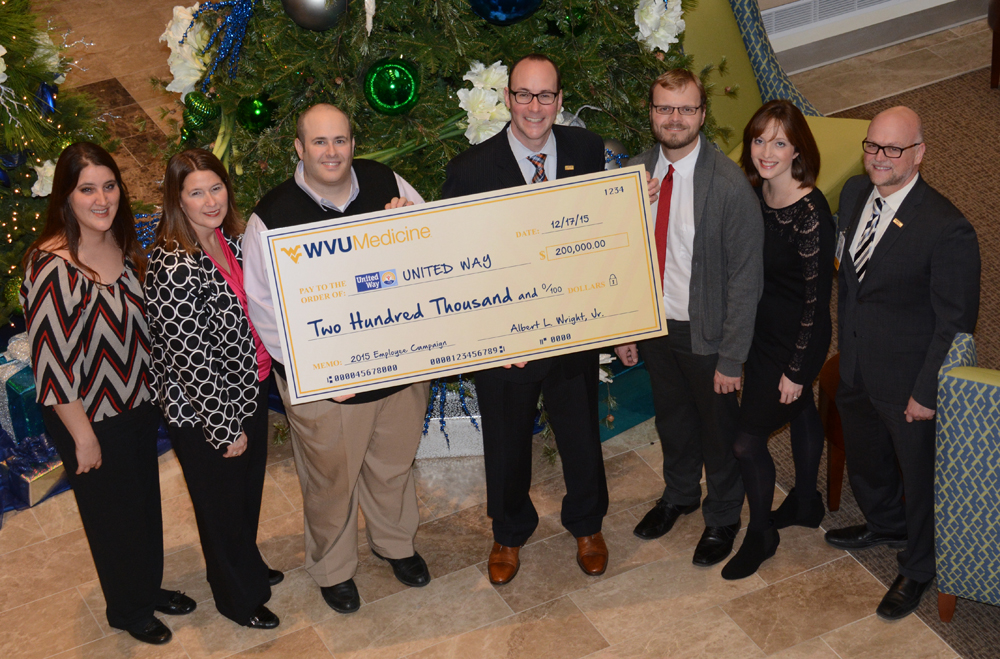 Pictured, left to right: Jamie Kiseli, WVU Medicine United Way Campaign co-chair; Brandi Helms, director, United Way of Monongalia and Preston Counties; Craig Behr, 2016 United Way of Monongalia and Preston Counties campaign chair; Albert L. Wright, Jr., president and CEO, WVU Medicine-WVU Hospitals; Patrick Murphy and Sara Fazenbaker, WVU Medicine United Way Campaign co-chairs; and Tony Condia, 2016 WVU Medicine United Way Campaign chair.