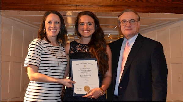 Dental student Kyla Swearingen receives an OKU award from Dr. Valerie Perrine and Dr. Anthony Tom Borgia.