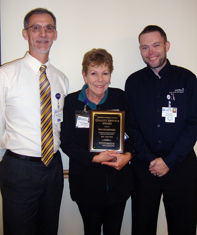 Vice President of Operations Neil McLaughlin, WVU Medicine Jefferson Medical Center's Quality Service Award Winner Faye Woodward and Dietary Operations Manager Chuck Kerr are pictured presenting the QSA second quarter award.
