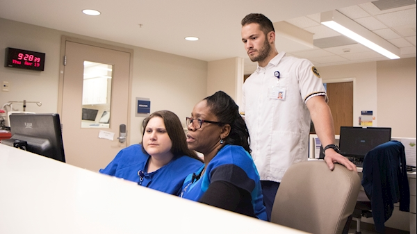 Sam Plantz, a graduating nursing student, observes fellow nurses at WVU Medicine.