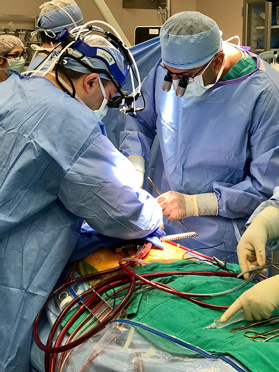 Dr. Vinay Badhwar (left) and Dr. Muhammad Salman perform the state's first heart transplant.