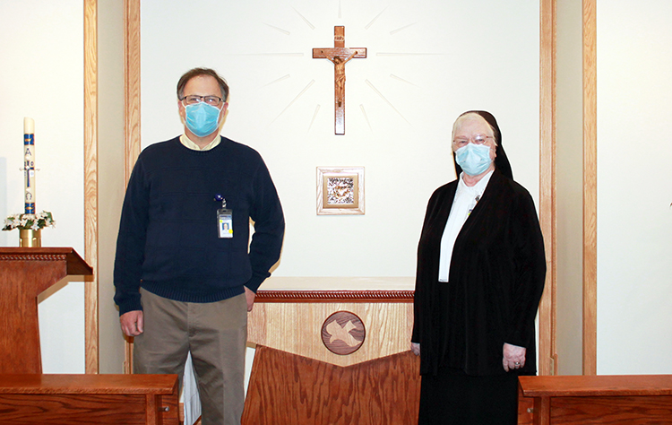 From left to right: Hospital Chaplain Barry Moll and Sister Francesca Lowis, vice president of mission integration, in the Hospital's Chapel