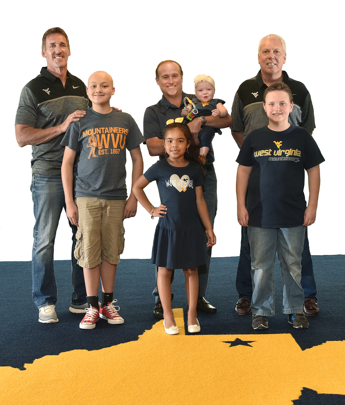 Jeff Hostetler, Dana Holgorsen, and Steve Antoline with WVU Medicine Children's patients