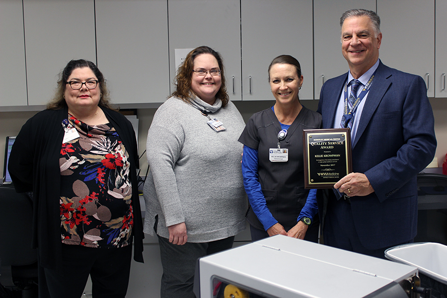 WVU Medicine Berkeley Medical Center's November Quality Service Award winner is pictured receiving her award.