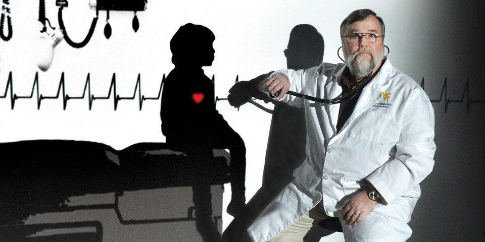 Larry Rhodes, cardiologist, examines a patient