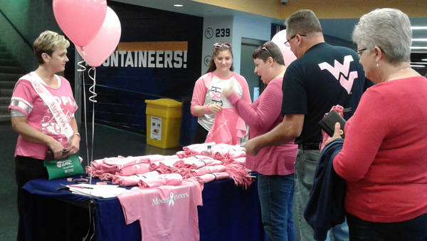 WVU volleyball team scores win and raises breast cancer awareness