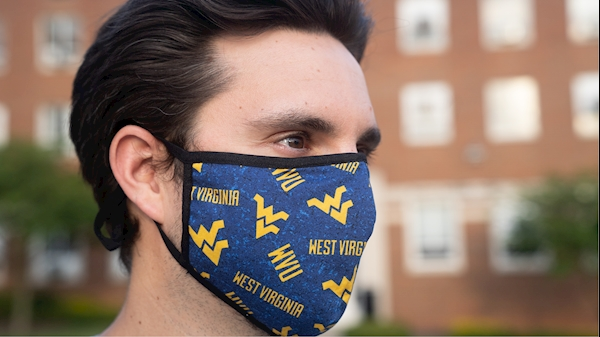 A person wears a flying WV face mask.