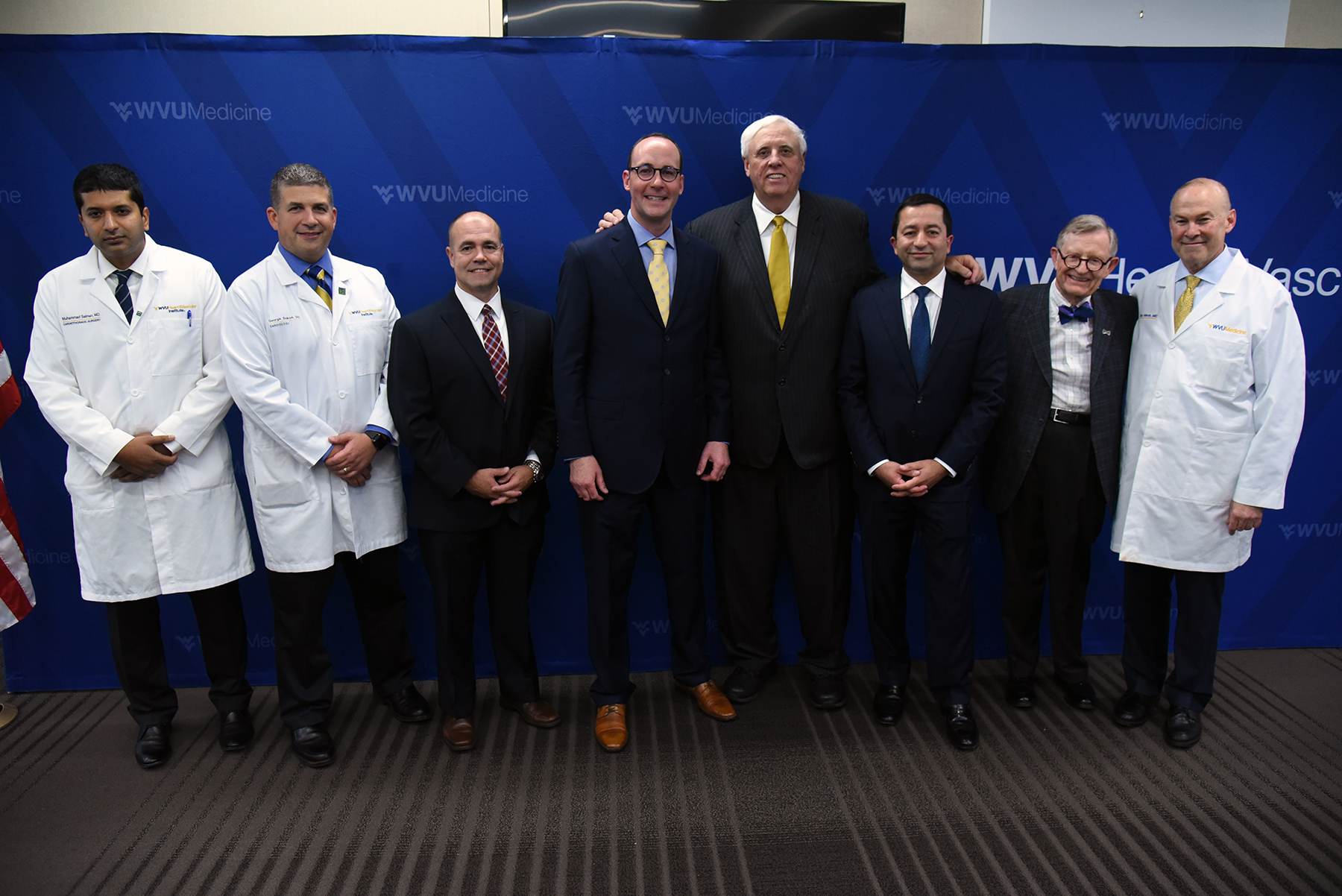 Gov. Jim Justic (fourth from right) joined WVU Medicine officials at a press conference today (Sept. 19) announcing plans to start a heart transplant program at the WVU Heart and Vascular Institute. Pictured with Justice are (from left to right) Muhammad Salman, M.D., cardiothoracic surgeon; George Sokos, D.O., cardiologist; Michael Shullo, associate vice president of transplant services; Albert L. Wright, Jr., president and CEO of the West Virginia University Health System; Justice: Vinay Badhwar, M.D., executive chair of the WVU Heart and Vascular Institute; Gordon Gee, WVU president and chair of the WVU Health System Board of Directors; and Clay B. Marsh, M.D., vice president and executive dean for WVU Health Sciences.