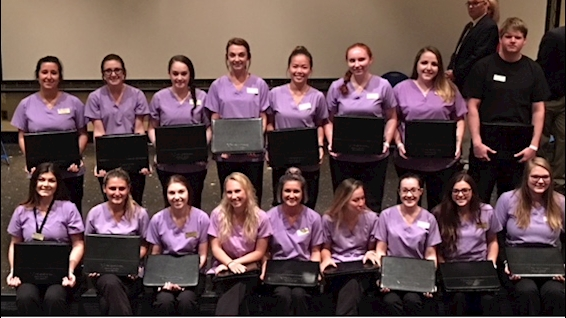 Dental hygiene seniors receive portfolios.
