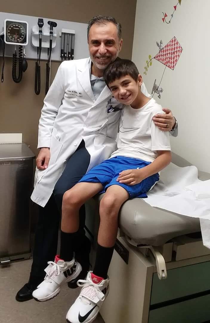 Osama Al-Omar, M.D., and patient Brayden Vance