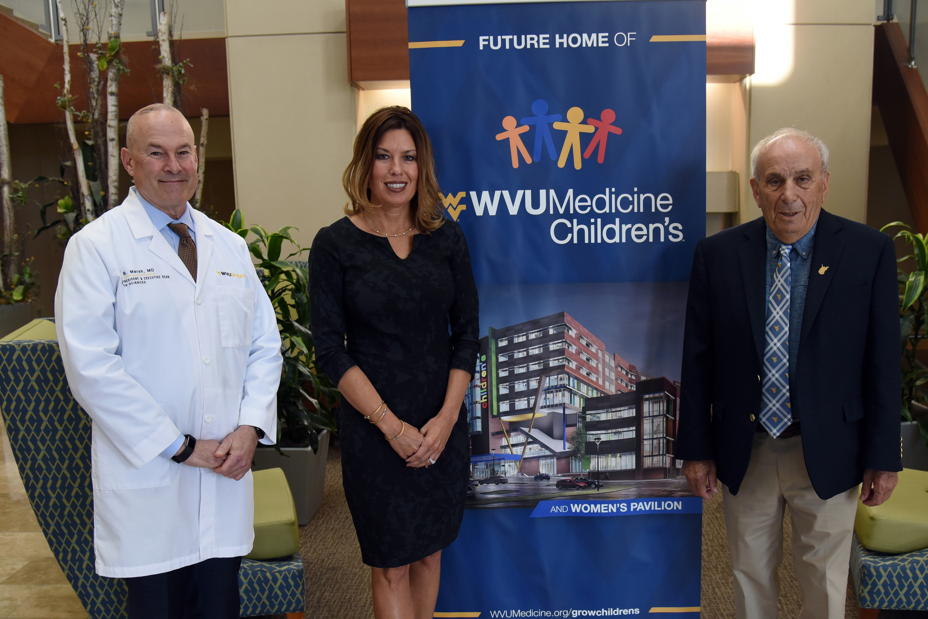 "Mike Ross, right, and his family have donated $1 million to WVU Medicine Children's ""Grow Children's"" Capital Campaign and the Brick Health Outreach Fund in the WVU School of Medicine. He is pictured with Dr. Clay Marsh, vice president and executive dean for health sciences, and Amy Bush Marone, WVU Medicine's chief operating officer."