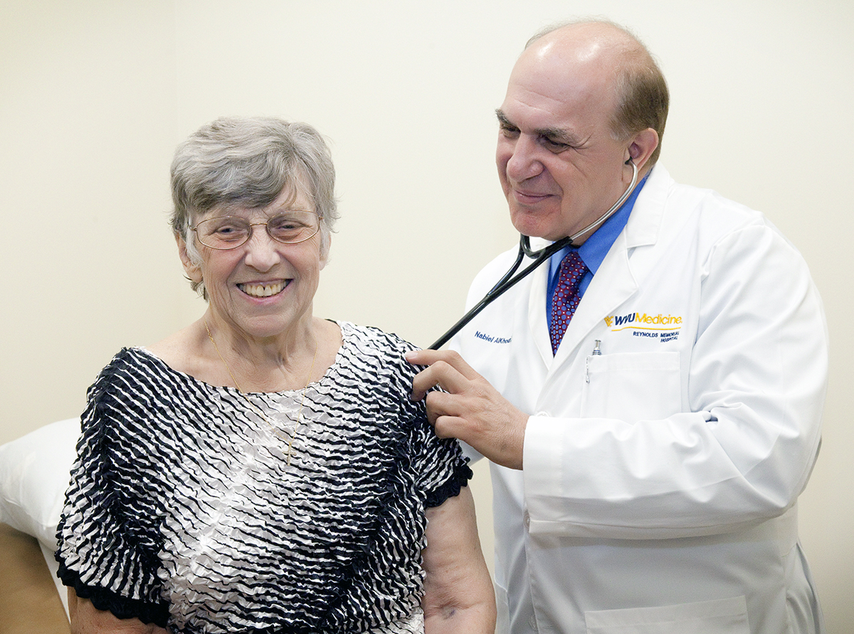 Nabiel AlKhouri, M.D., examines Kathryn Renshaw, one of the first patients at the WVU Cancer Institute in Glen Dale.