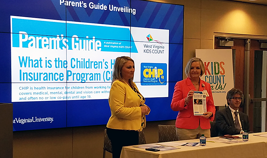 WV KIDS COUNT Director Tricia Kingery; Cheryl Jones, assistant vice president for WVU Medicine Children's ; and Christopher Plein, Ph.D., co-author of the issue brief and Eberly Family Professor for Outstanding Public Service at WVU
