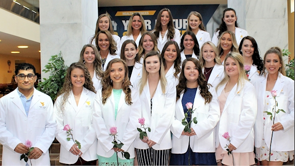 Dental hygiene students presented with white coats