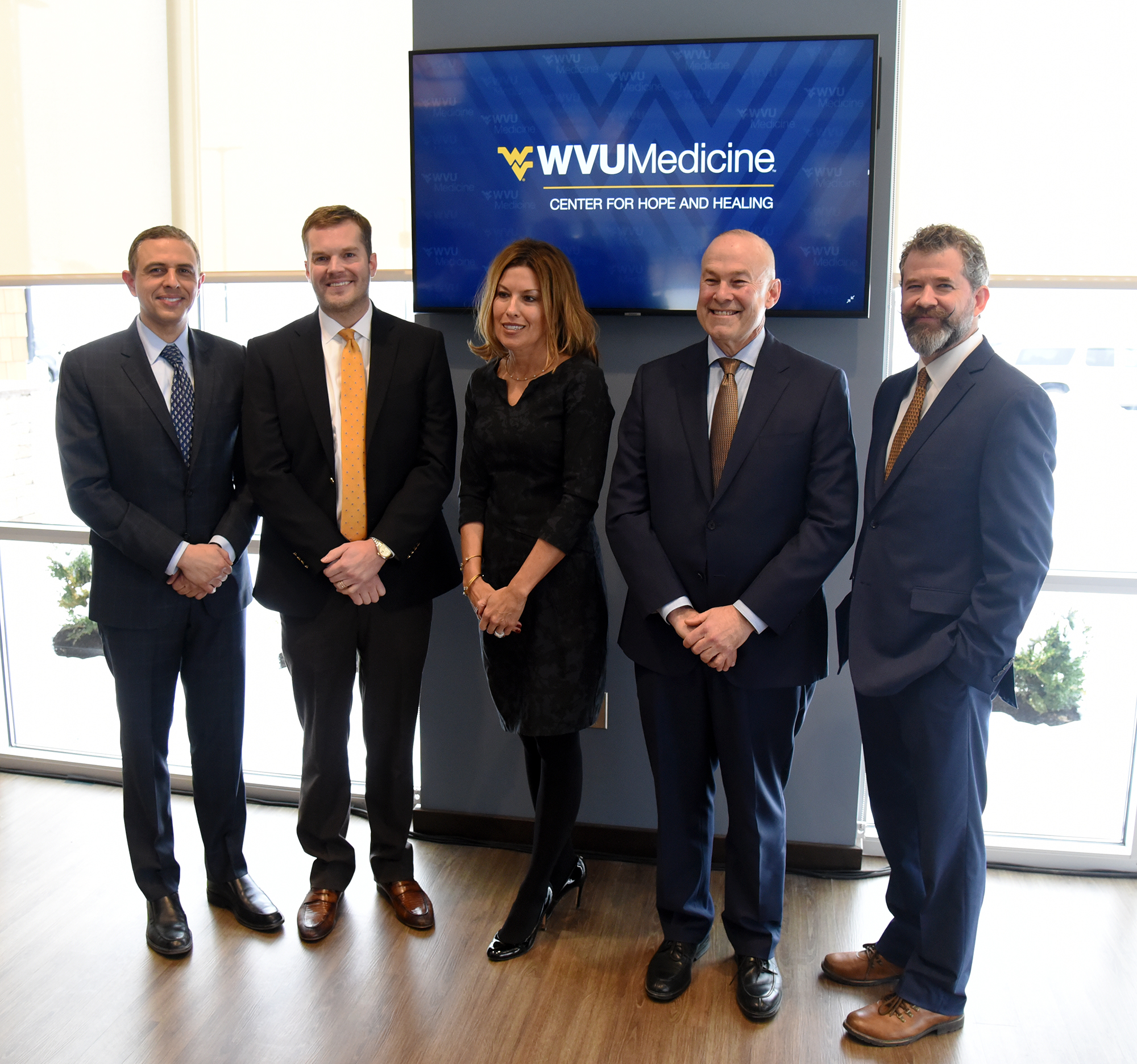 (From left to right) Ali Rezai, M.D., executive chair of the WVU Rockefeller Neuroscience; Douglas M. Leech, founder and CEO of Ascension Recovery Services; Amy Bush-Marone, R.N., B.S.N., M.B.A., WVU Medicine vice president of clinical operations; Clay B. Marsh, M.D., vice president and executive dean of WVU Health Sciences; and James Berry, D.O., director of addiction services, WVU Medicine Chestnut Ridge Center, and interim chair, WVU Department of Behavioral Medicine and Psychiatry, were among those gathered to celebrate the opening of the WVU Medicine Center for Hope and Healing today (March 1).