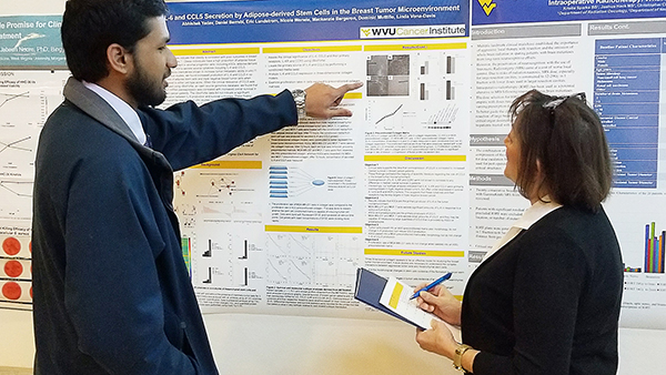 Abhishek Yadev, a medical school student in the lab of Linda Vona Davis practices his poster presentation for 2018 Van Liere poster competition.