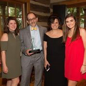 Dr. Bill Petros with his family at his Crystal Award presentation.