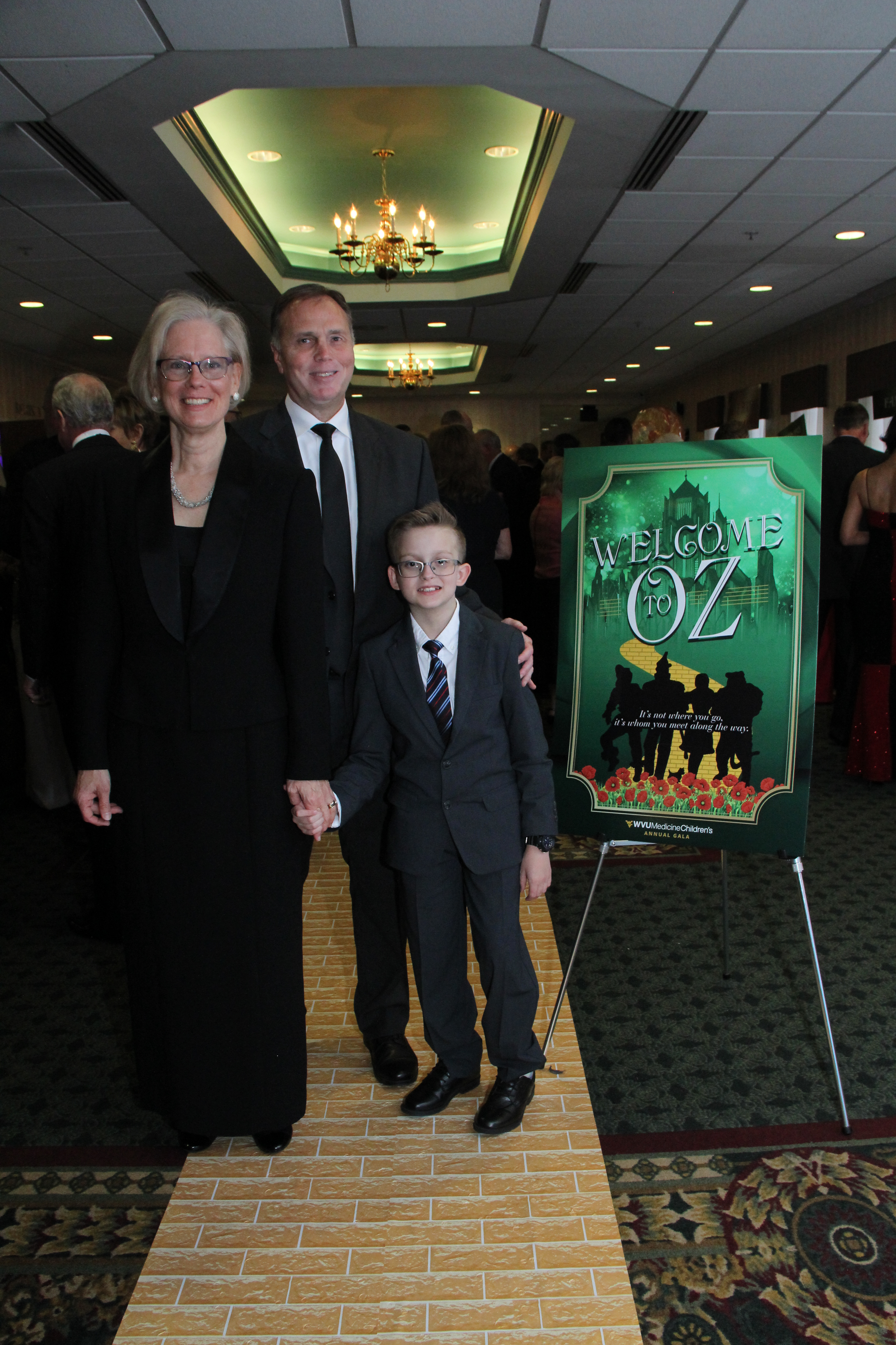 Wyatt Brady, the miracle story child for the 2019 WVU Medicine Children's Gala in the Eastern Panhandle, is shown walking the yellow brick road with his parents, Helena and Lee Brady.