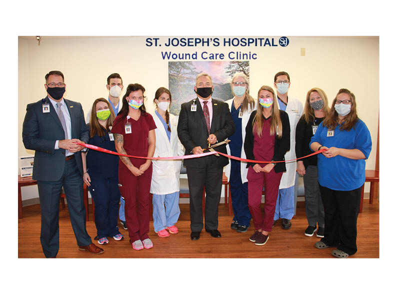 Photo, Left to Right: Rodney Baker, Vice President of Ancillary Services and Physician Practices; Toni Barger, LPN; Addison Michael, DPM; Brandi Gilles, CNA; Jennifer Michael, DPM; Skip Gjolberg, President of St. Joseph's Hospital; Bonnie Blackburn, PA-C; Kaylee Clifton, CNA; Ross Knowles, DO; Cindy Hardman, Ambulatory Clinic Manager, and Shannon Milligan, Clinic Receptionist.