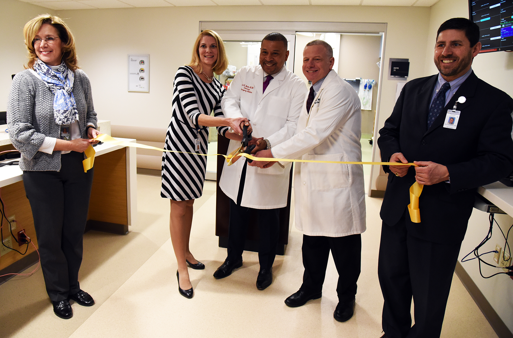 From left to right) Judie Charlton, M.D., WVU Medicine chief medical officer; Valerie Boley,R.N., B.S.N., director of Emergency Services; Ian B.K. Martin, M.D., M.B.A., chair of Emergency Medicine; Owen Lander, M.D., medical director of the WVU Medicine Center for Emergency Medicine; and Doug Mitchell, B.S.N., M.B.A., chief nursing officer, cut the ribbon to officially open the newly renovated WVU Center for Emergency Medicine.