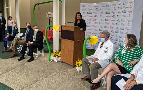 Amy L. Bush, chief operating officer for WVU Medicine Children's, speaks at event held today (April 28) in Huntington to celebrate a clinical affiliation between Hoops Family Children's Hospital and WVU Medicine Children's.