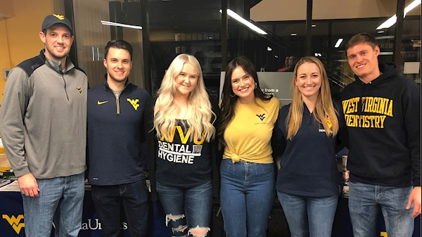 Students promote tobacco cessation at a WVU Mountaineer game.