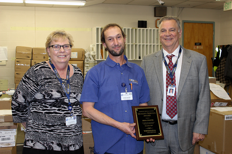 WVU Medicine Berkeley Medical Center's December Quality Service Award winner is pictured receiving his award.