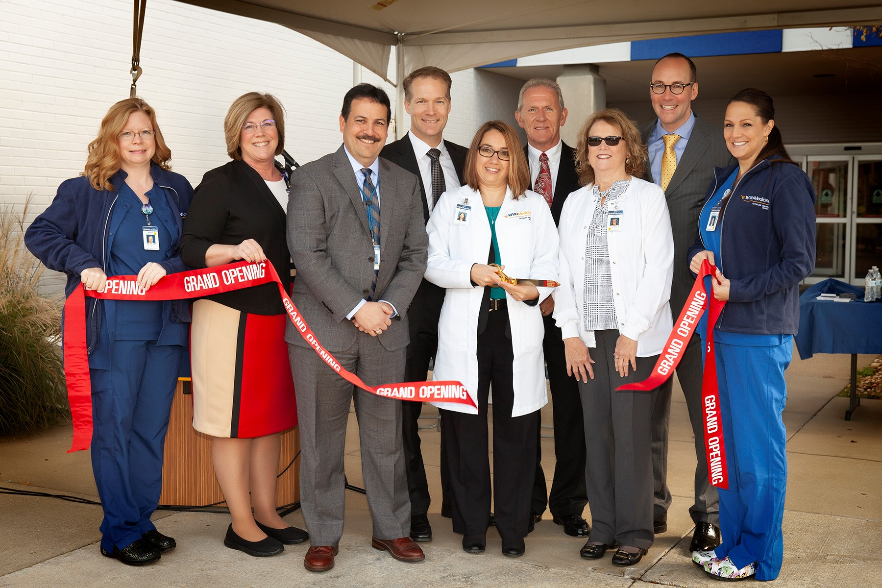 (From left to right) Mary Clegg, Women's and Newborn Center nurse; Margaret Denny, Director of Nursing, Reynolds Memorial Hospital; Mike Ortiz, VP of Clinical Operations, Reynolds Memorial Hospital; David Hess, M.D., president and CEO, Reynolds Memorial Hospital; Nicole Carlson, M.D., Reynolds Memorial Hospital; Bernie Twigg, Chairman of the Board of Directors, Reynolds Memorial Hospital; Kathy Meyer, Women's and Newborn Center Nurse Manager, Reynolds Memorial Hospital; Albert L. Wright, Jr., president and CEO, WVU Health System; and Amanda Zelkowski-Elliott, Women's and Newborn Center nurse, Reynolds Memorial Hospital