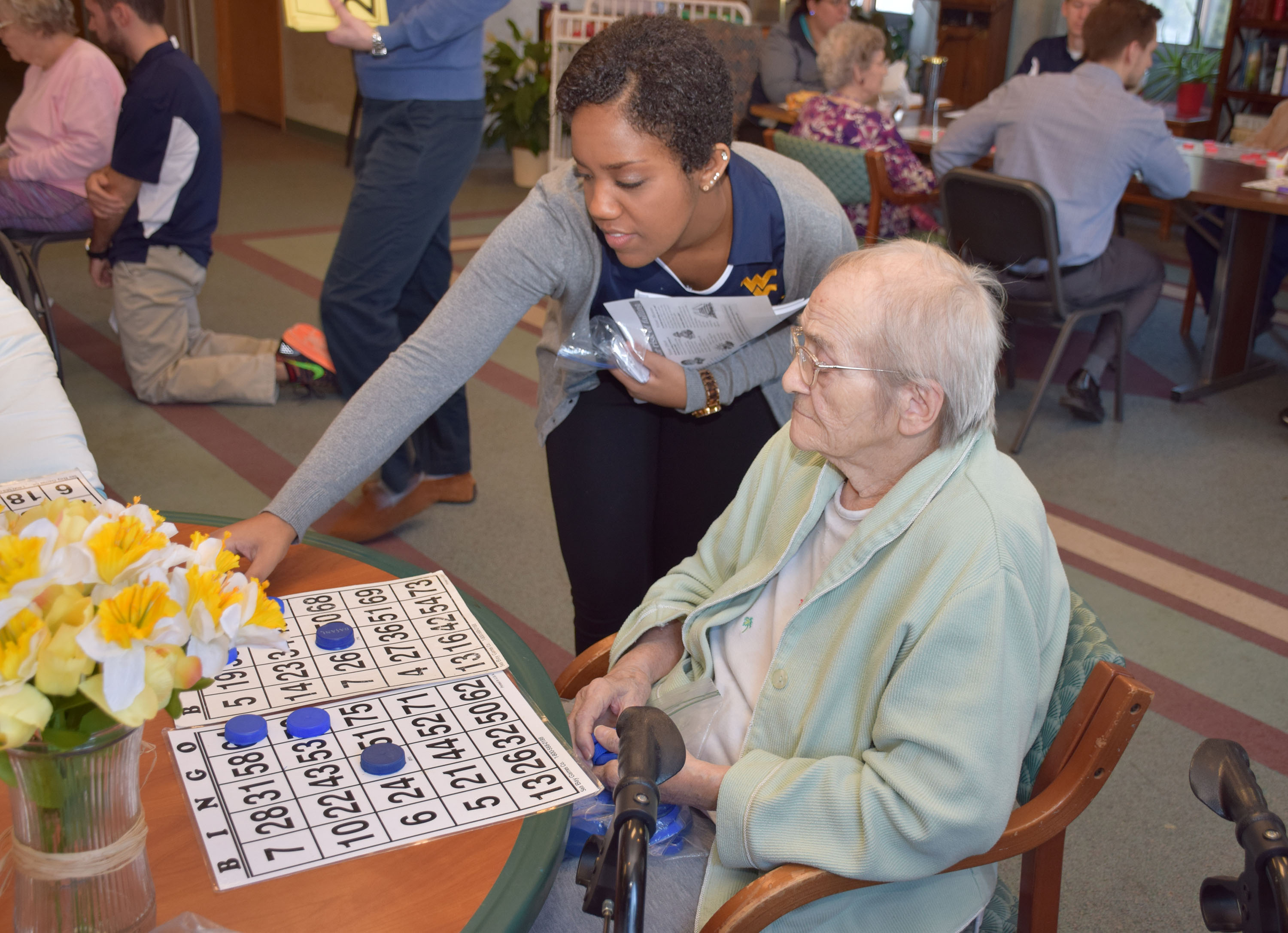WVU student pharmacist Rebecca Berhanu (left) works with Sundale resident Mary Stump.