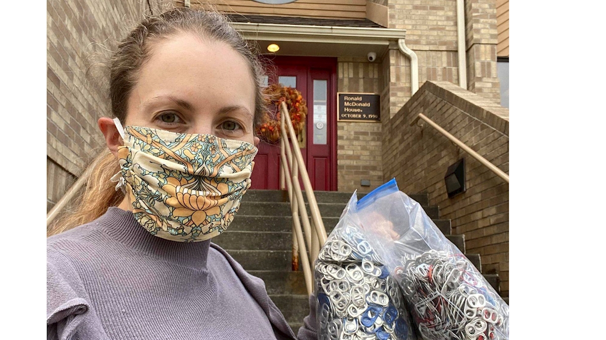 Dr. Claydon takes a selfie in her mask just before turning in a large bag of soda can tabs to the Ronald McDonald House.