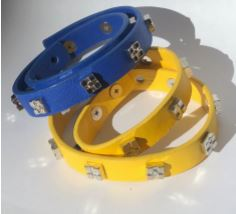 Gold and blue banded bracelets include bracketears on them as bling.