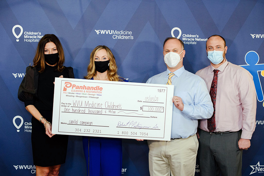 (From left to right) Amy L. Bush, R.N., M.S.N., M.B.A., chief operating officer for WVU Medicine Children's, and Marisa Sayre, marketing manager for WVU Medicine Children's, accept a $100,000 donation from Bob and Josh Contraguerro from Panhandle Cleaning and Restoration.