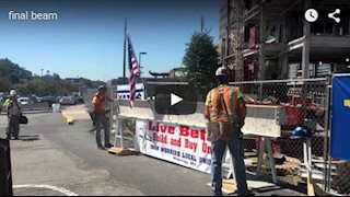 Final beam of Southeast Tower raised during topping out ceremony (Video)