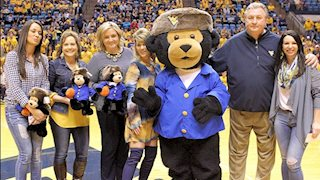Hugs all around: Friends of WVU Hospitals donates $5,000 to Cancer Research Fund named for coach Bob Huggins' mother