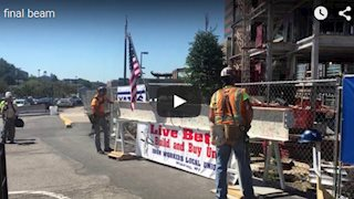 New video, photo gallery from topping out ceremony, beam signing available