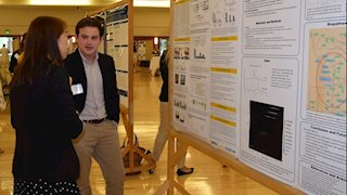 Patrick Thomas, poster winner at undergraduate research symposium