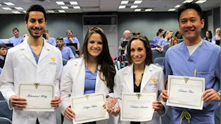 Students named winners in dental research competition