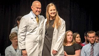 Transitioning from basic science to clinical care, 2nd-year WVU medical students earn white coats
